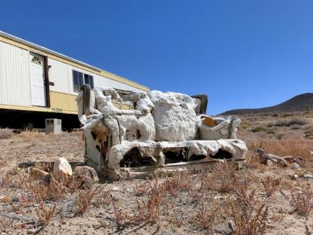 Dead trailer in a desert.