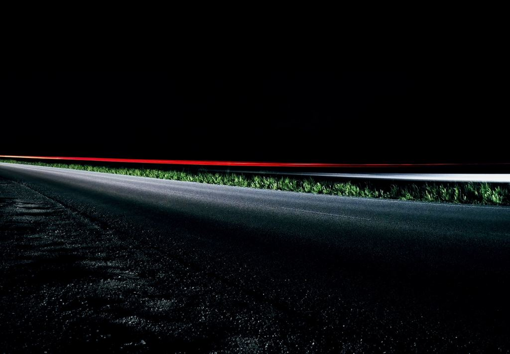 Dark road with car taillights streaming by