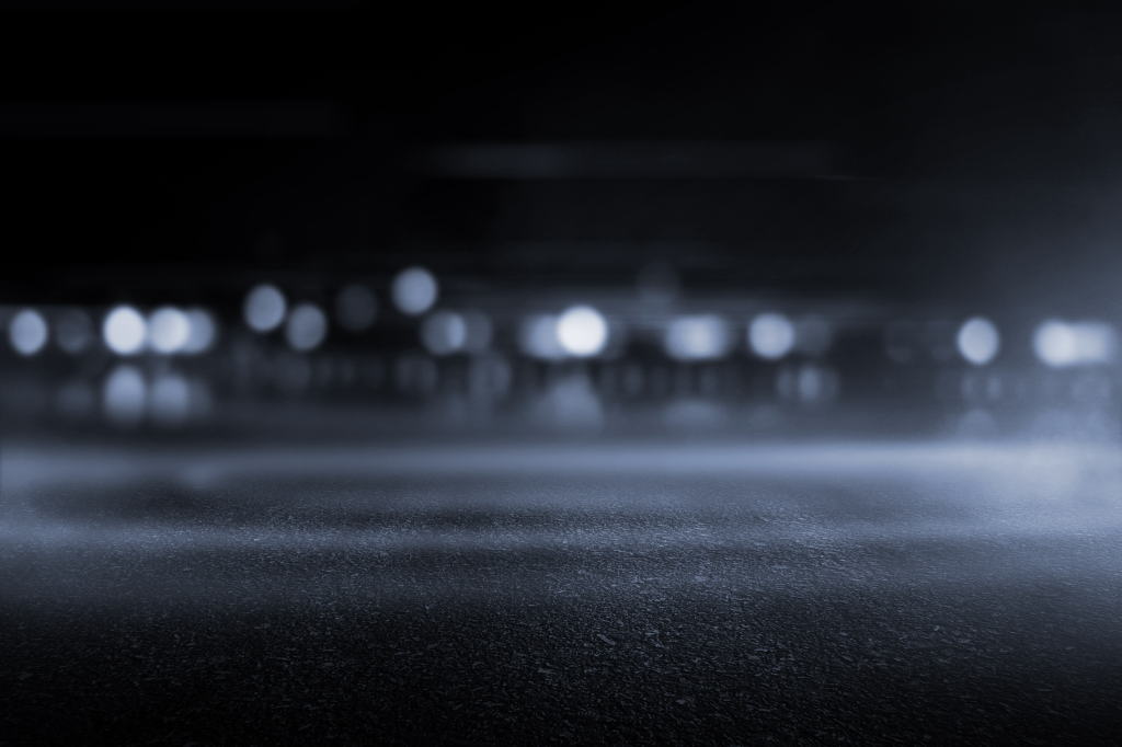 Empty parking lot at night.