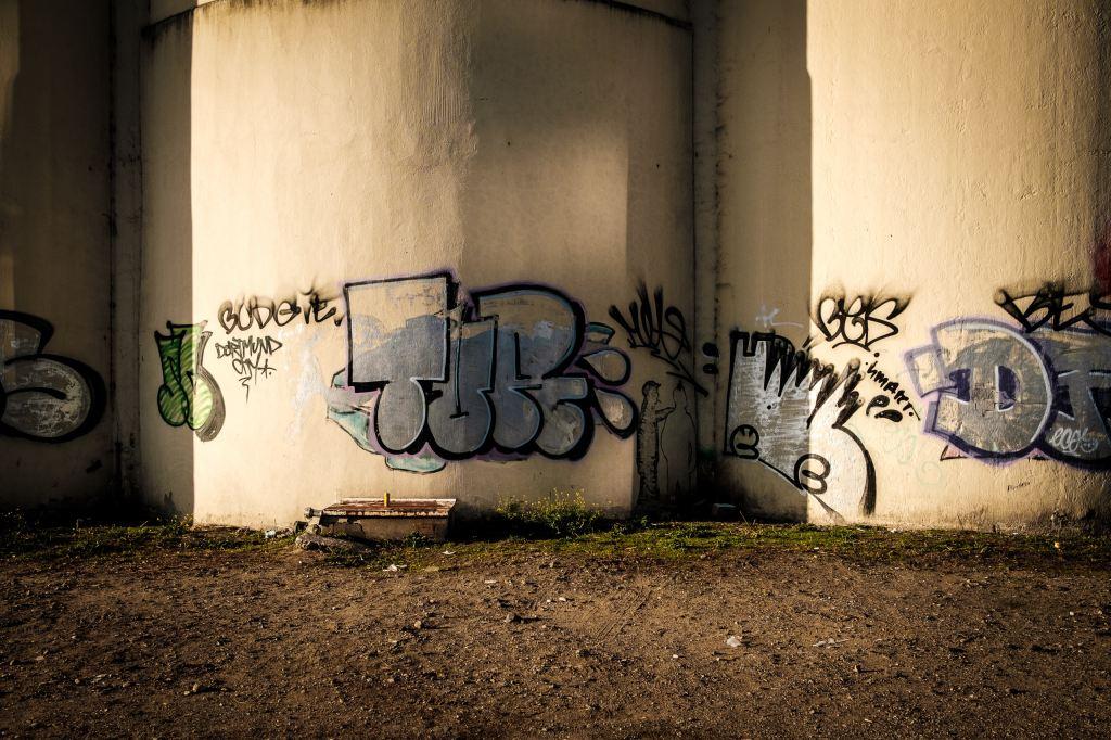 Grafitti under a freeway overpass