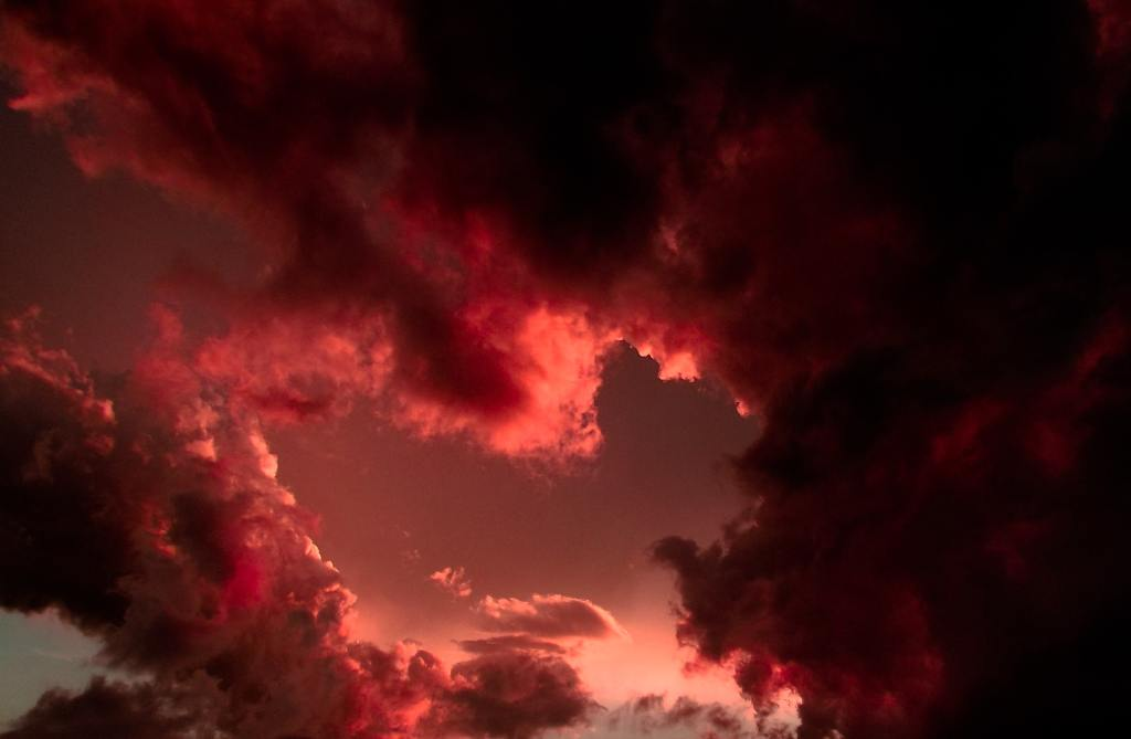Red clouds in a dark sky