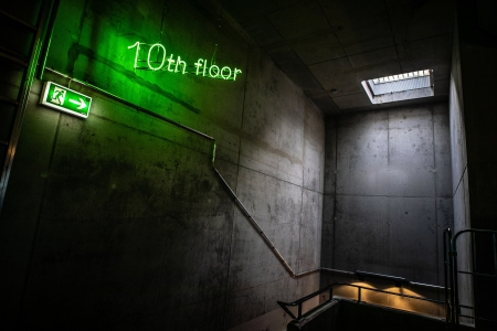 10th floor sign in a concrete stairwell