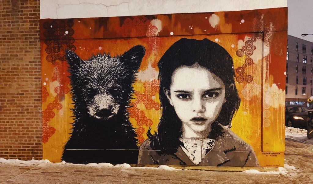 Graffiti of a bear cub and a child