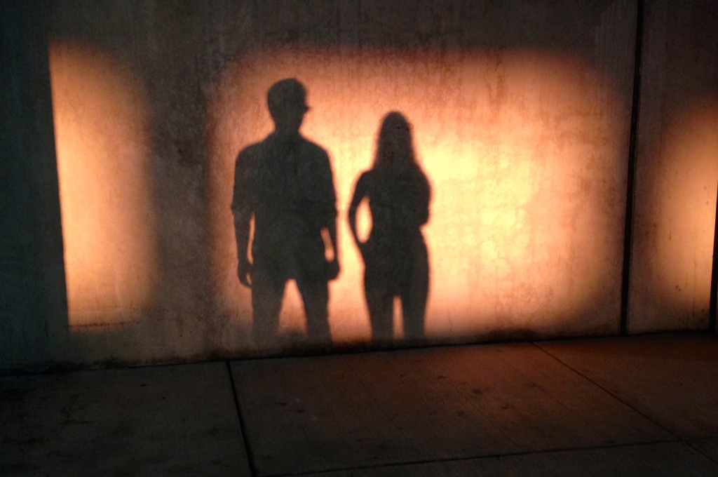 The band, Lore City, in silhouette