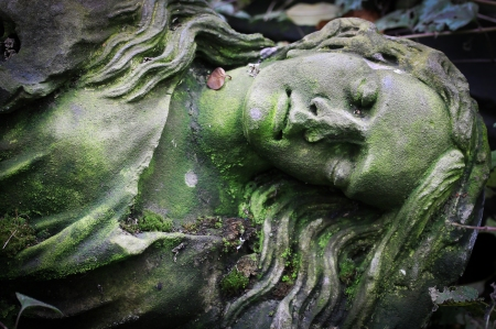 Old statue in a cemetery in Prague