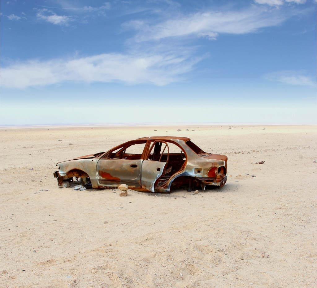Abandoned car in the desert.